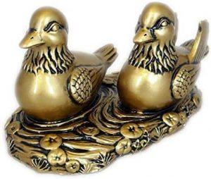 figura de patos imitación bronce