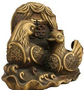 estatua de latón de patos